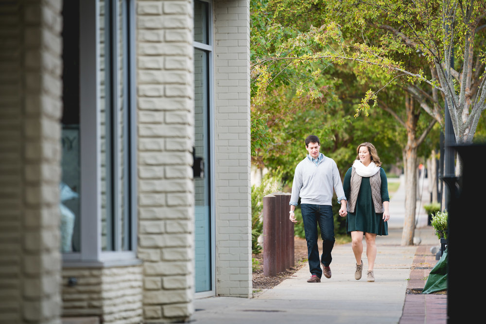 Couple walking down the street | Engagement Session Downtown Greenville, SC