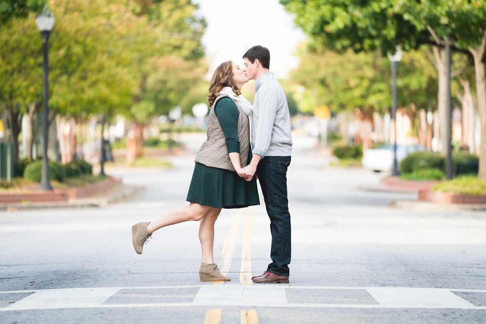 Couple kissing in the street | Engagement Session Downtown Greenville, SC