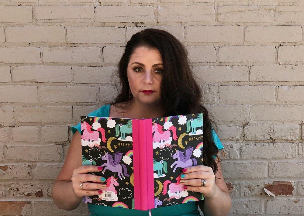 Kayla Brissi holding a book