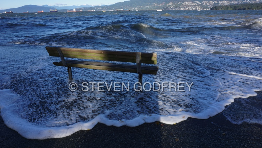 Surging seas: a king tide pushes up and over the seawall at Kitsilano Beach | Vancouver, British Columbia, Canada
