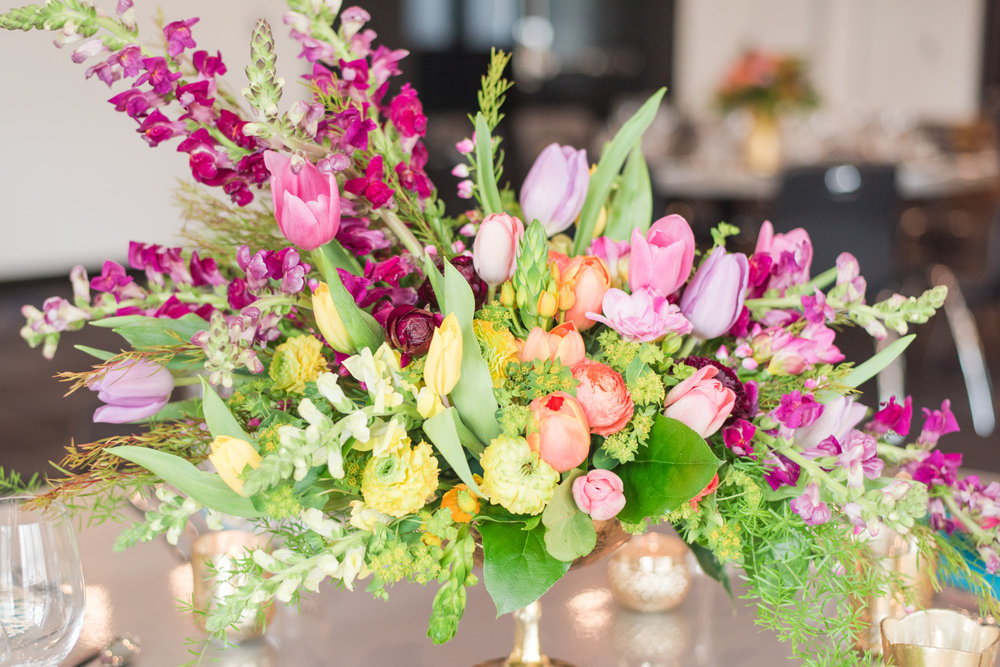 Bright tulips, green, purple, yellow, pink, ombre reception centerpiece  Jessica Wonders Events, Minneapolis, MN
