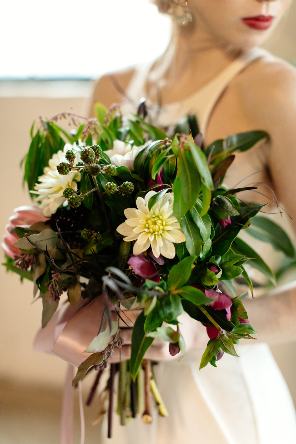 White greenery and dark red bouquet  Jessica Wonders Events, Minneapolis, MN