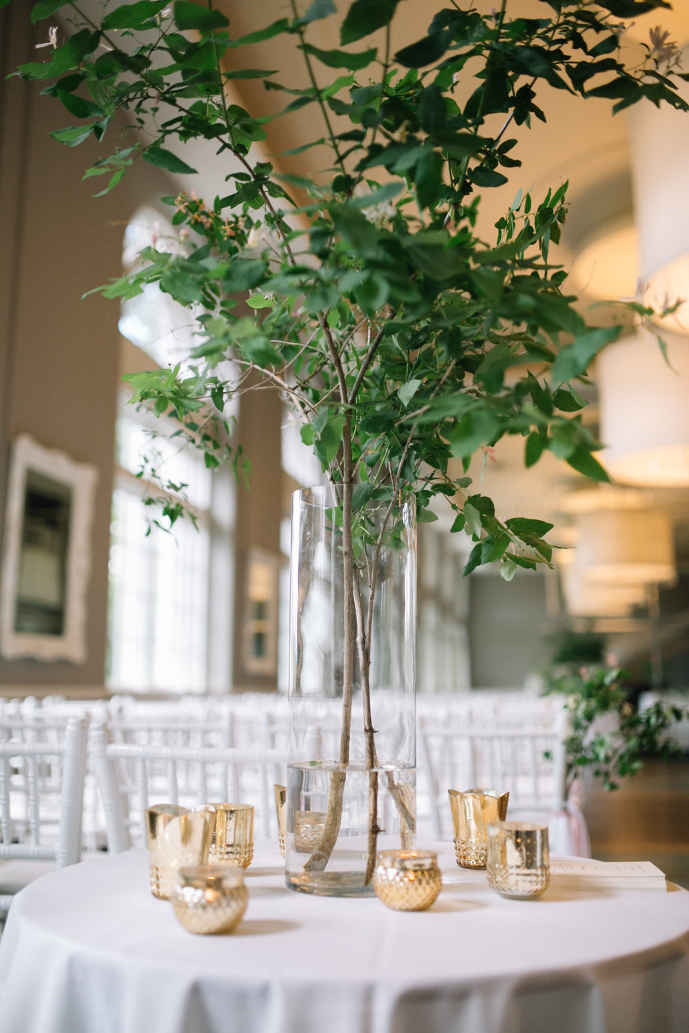 Greenery in cylinder vase tall centerpiece  Jessica Wonders Events, Minneapolis, MN
