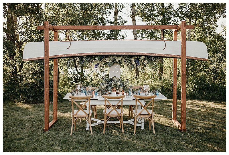 Canoe Hanging above table, hanging flowers installation. Jessica Wonders Events, Minneapolis, MN Event Planner, Floral Designer