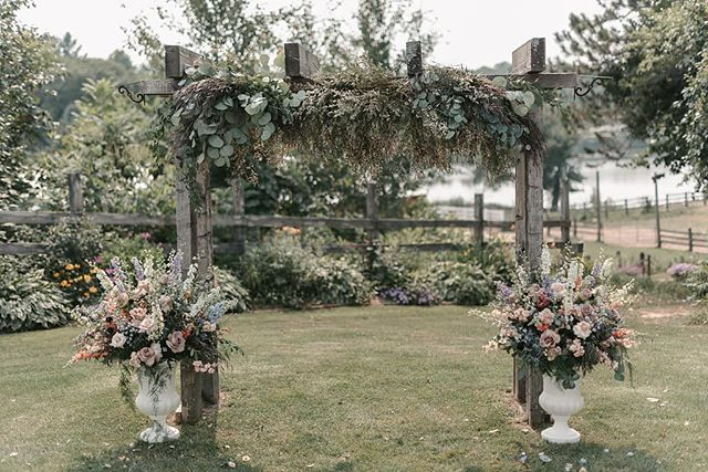 A ceremony arch designed for the whimsicle at heart. Photo @ericlundgren  Floral/Planning @jessicawondersevents
