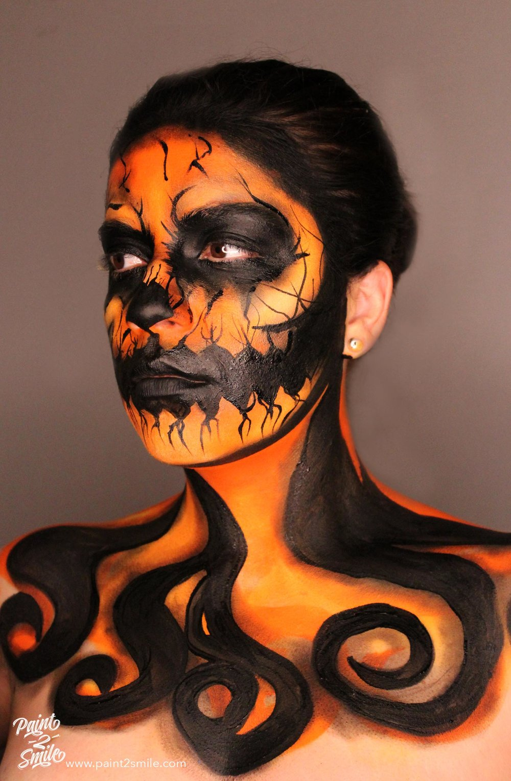 Jack o lantern face painting left side