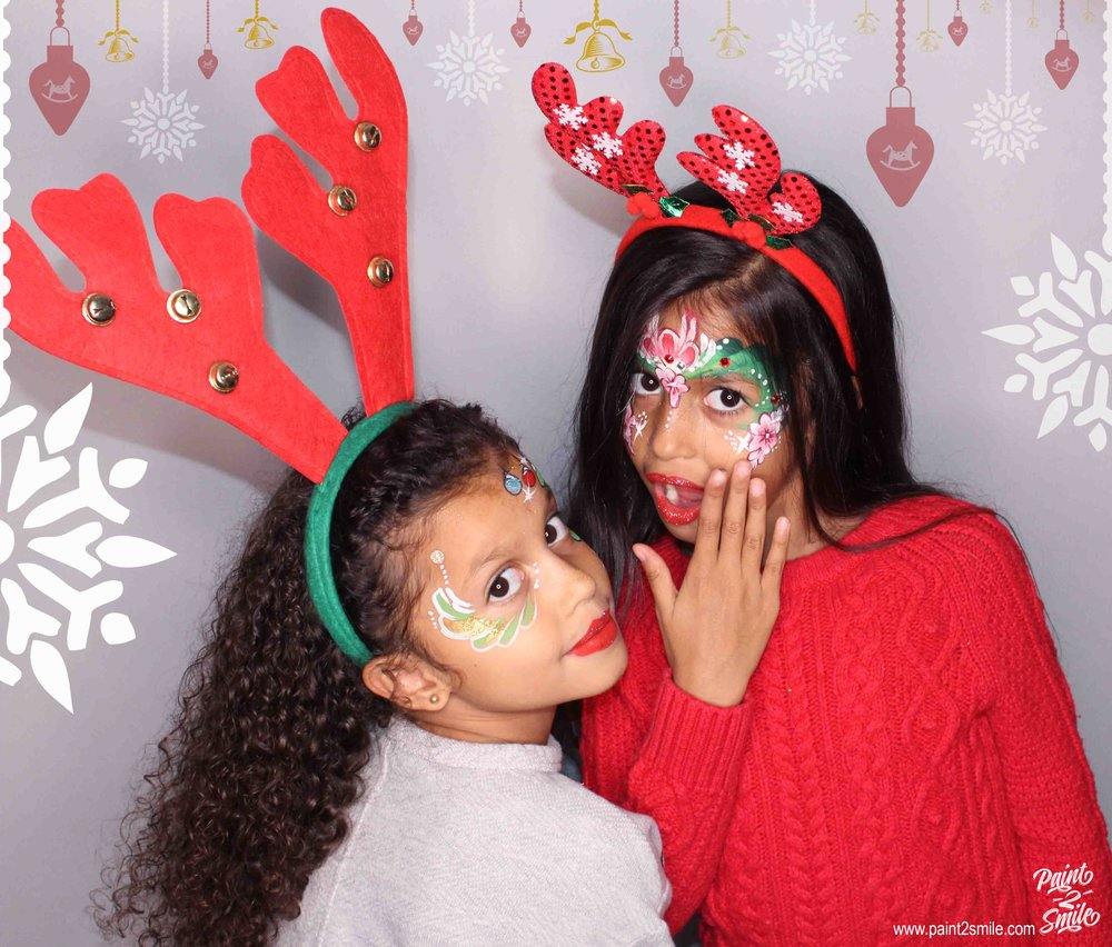 Christmas face painting two girls photo