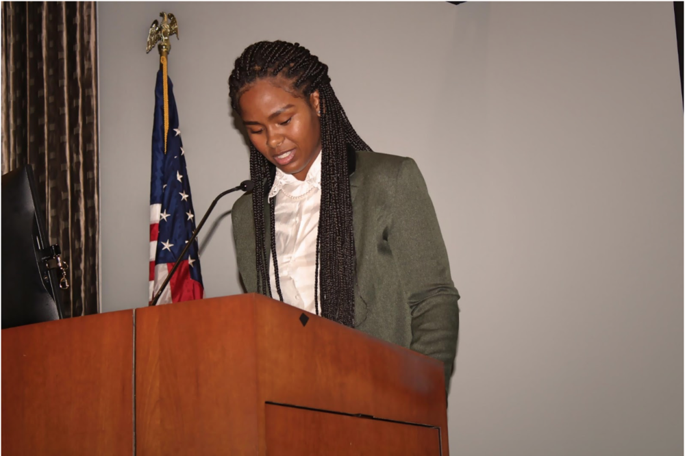"""Christell Roach (C'19), reading """"Blues in Bb"""" by Mari Evans"""