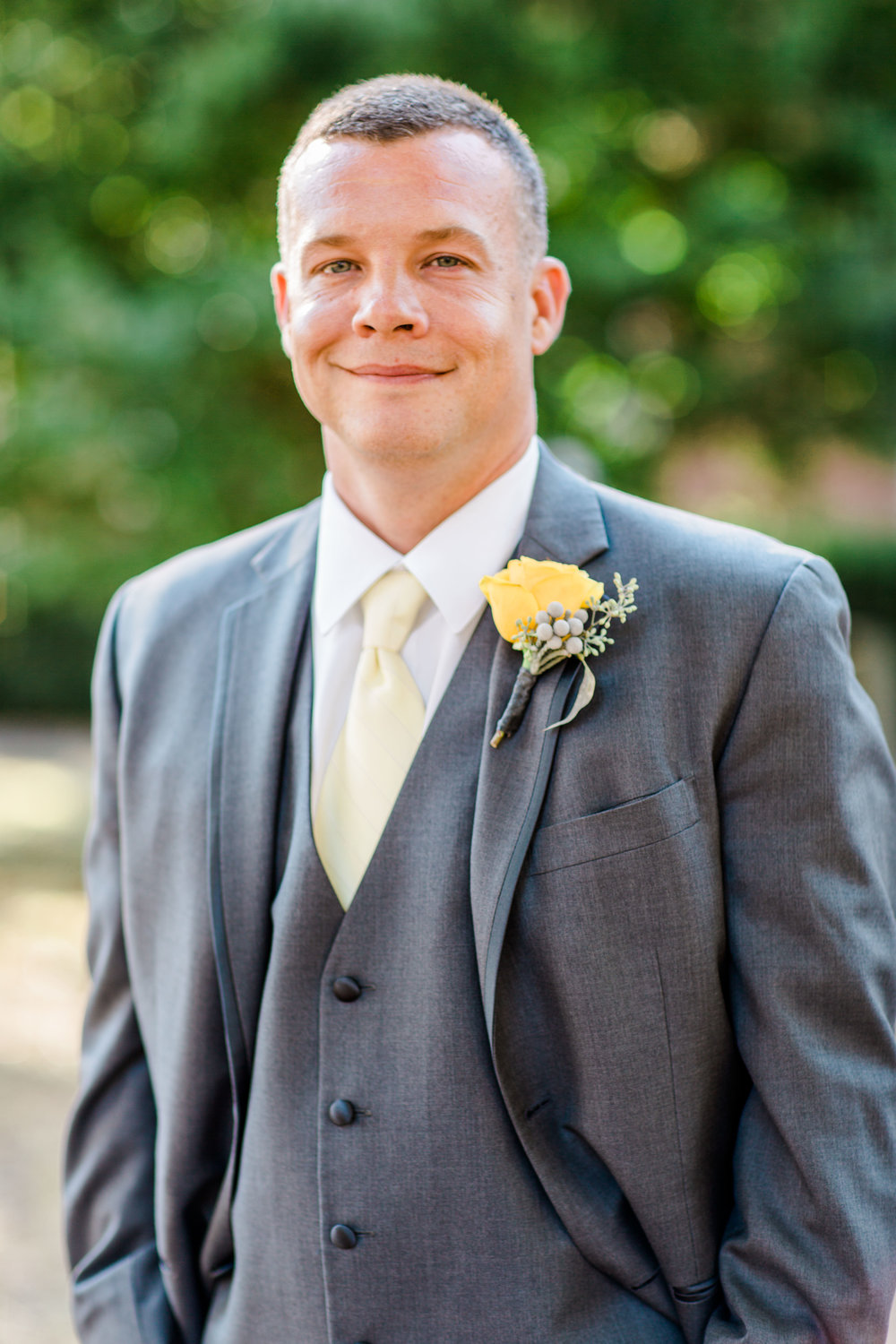 Photography of groom smiling outside of Oscar-Getz during Bardstown, Kentucky wedding.