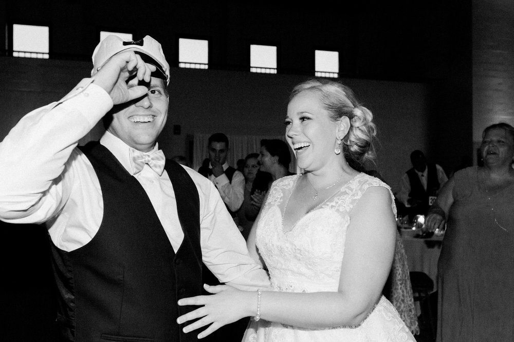 Bride and groom laughing at Bellarmine university wedding reception in louisville ky