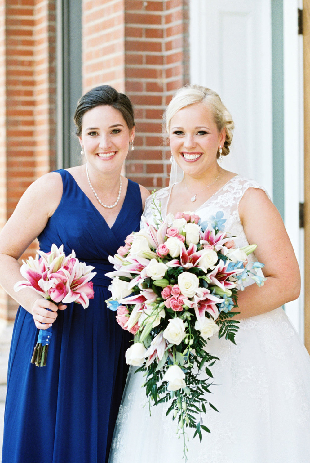 Bride with bridesmaid at louisville ky wedding st agnes