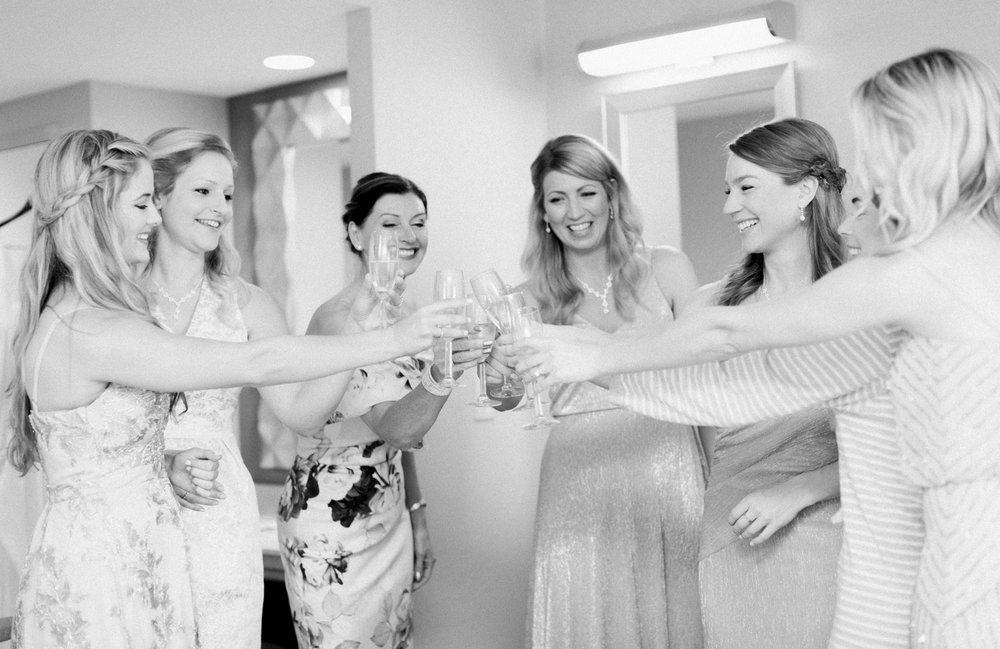 bridesmaids and bride and mother of the bride cheers