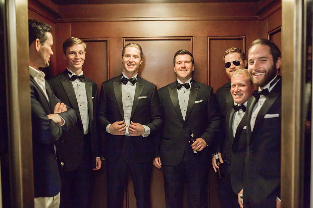 Groom and groomsmen in an elevator before the wedding ceremony