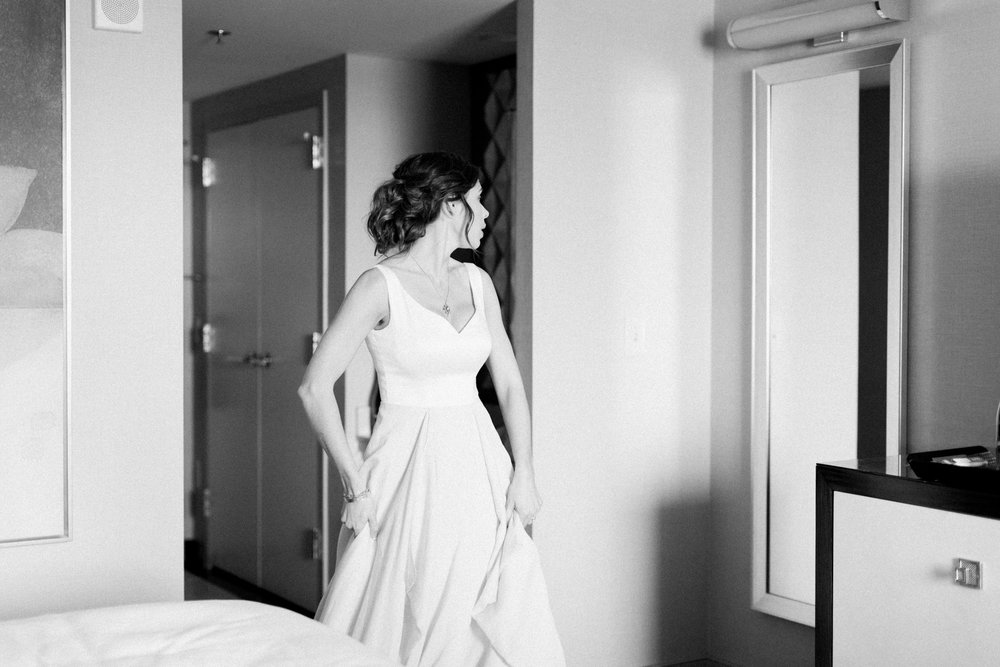 bride looking in mirror before her wedding