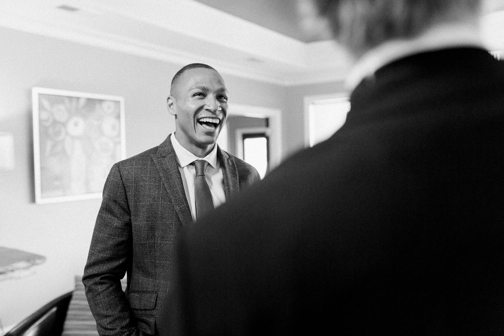 man laughing at little turtle wedding in columbus ohio