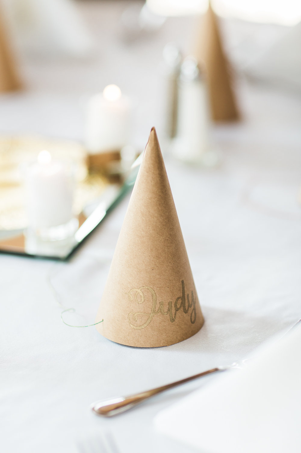 brown paper hats for wedding with calligraphy names on them