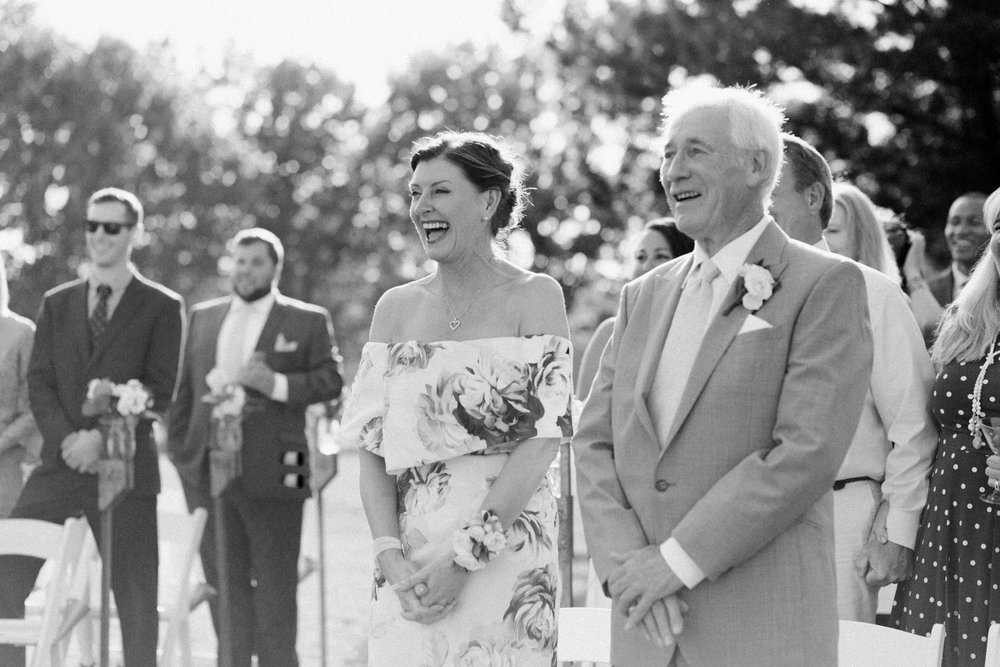 mom and dad laughing at little turtle club outdoor ceremony in columbus ohio