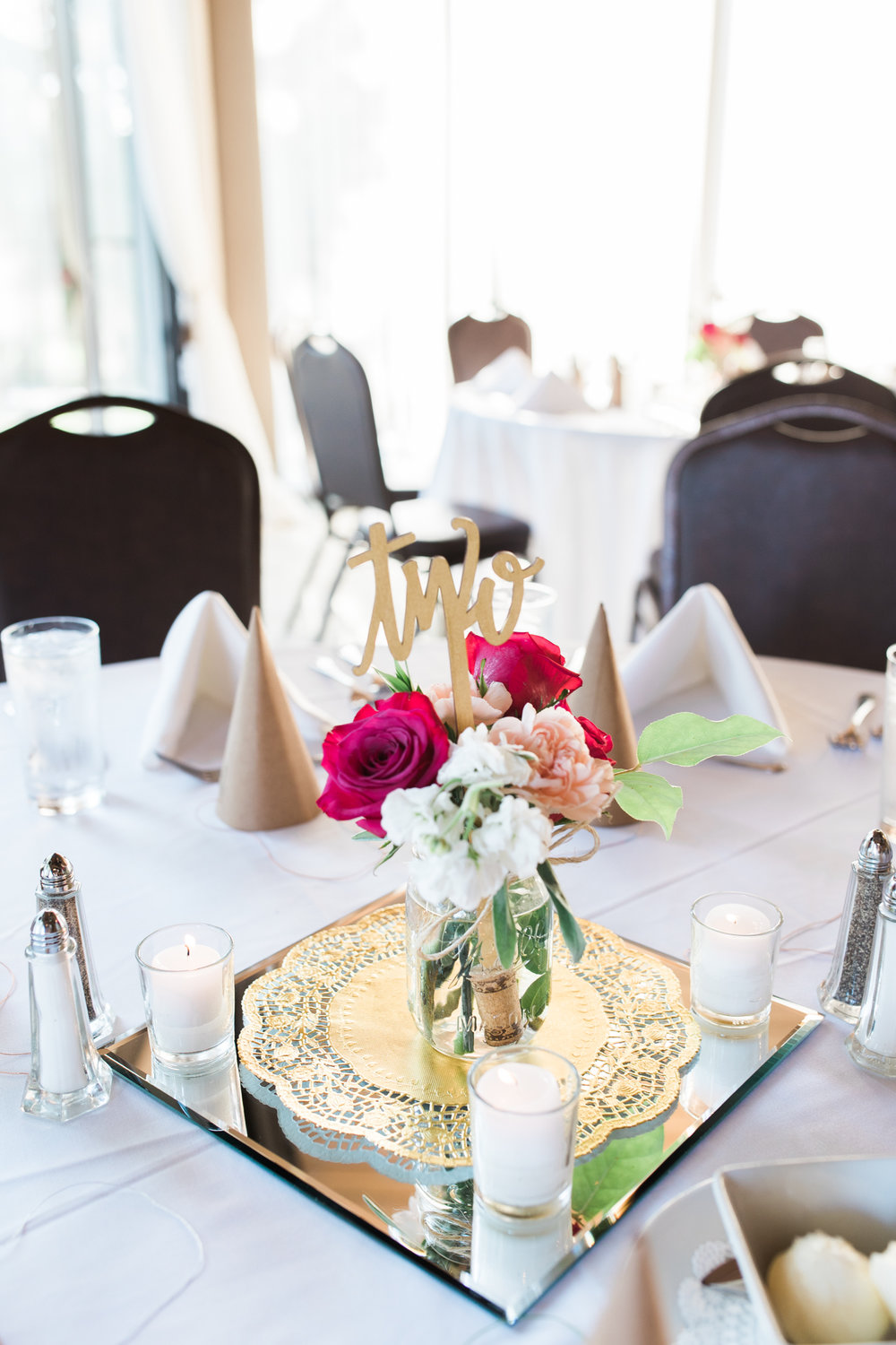 centerpiece with pink and white flowers and gold hand lettered cut out sign at little turtle club wedding in columbus ohio
