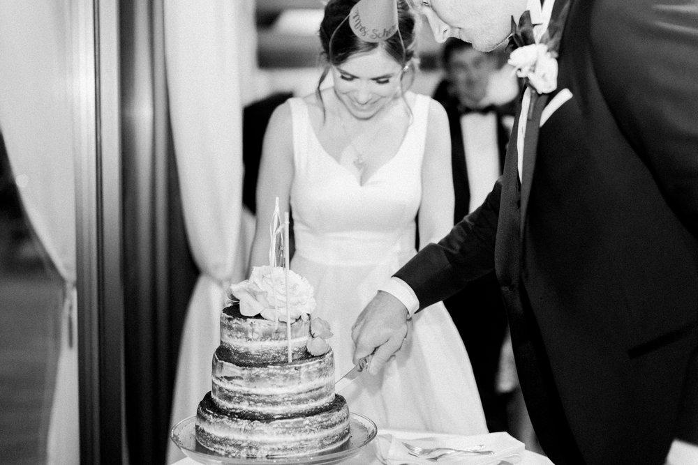 cake cutting at little turtle club wedding in columbus ohio