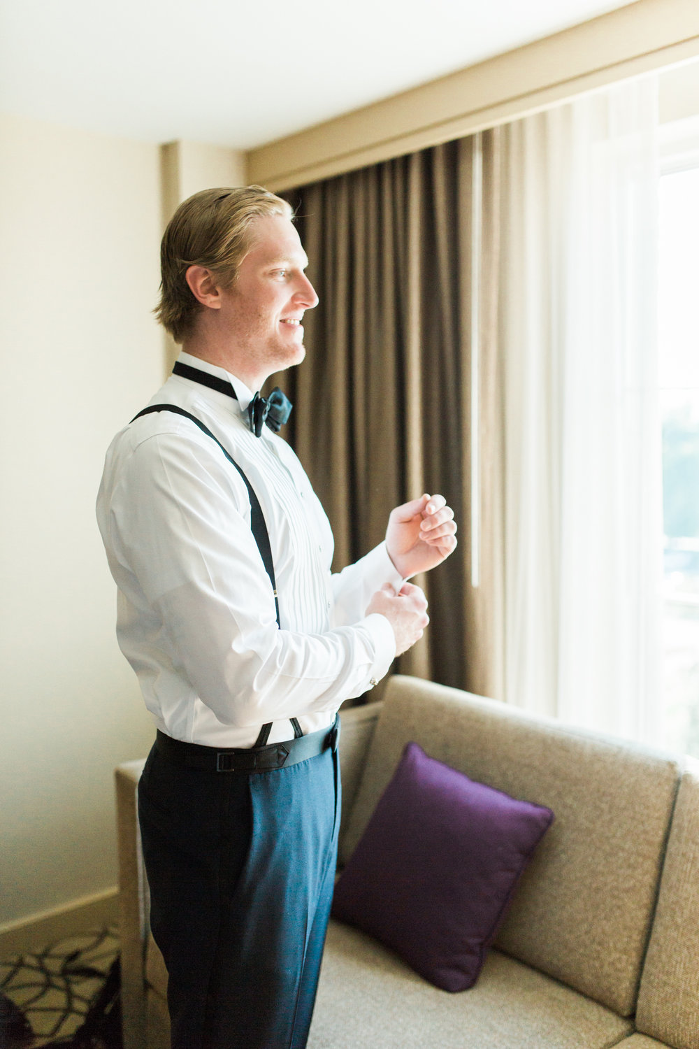 groom getting ready at hotel for wedding