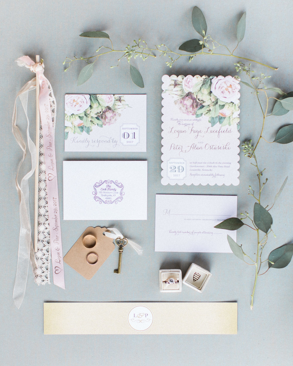 flat lay of mrs box and invitation suite and ribbon streamer