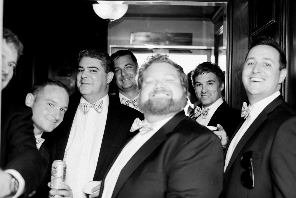 groomsmen in elevator
