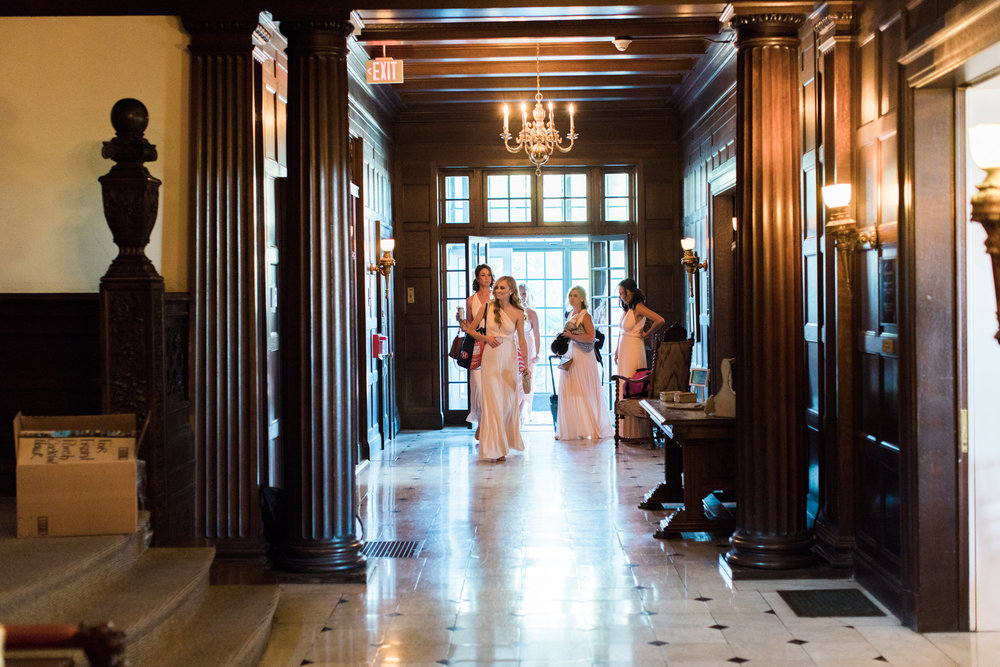 Bridesmaids entering Garden Court before the wedding ceremony