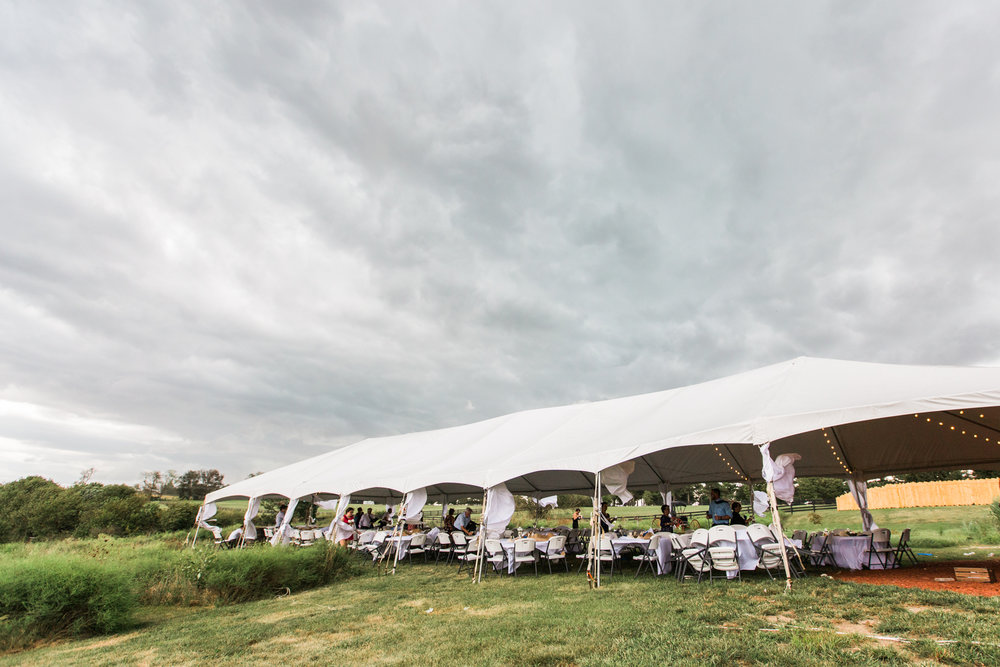 Prepare for weather on your wedding day--tent under stormy clouds at Moonlight Fields Wedding Venue