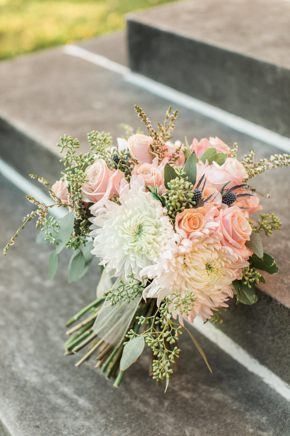 Bouquet outside on steps at Gardencourt Louisville Wedding Venue
