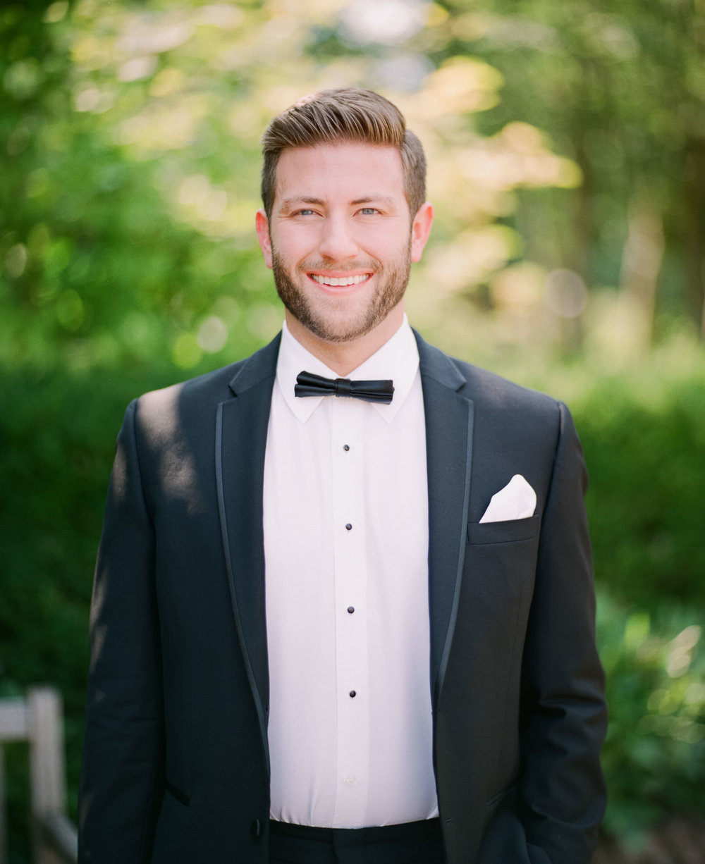 Image of groom smiling taking using Pentax 67 with Schneider Cinelux Ultra MC 120mm f/2