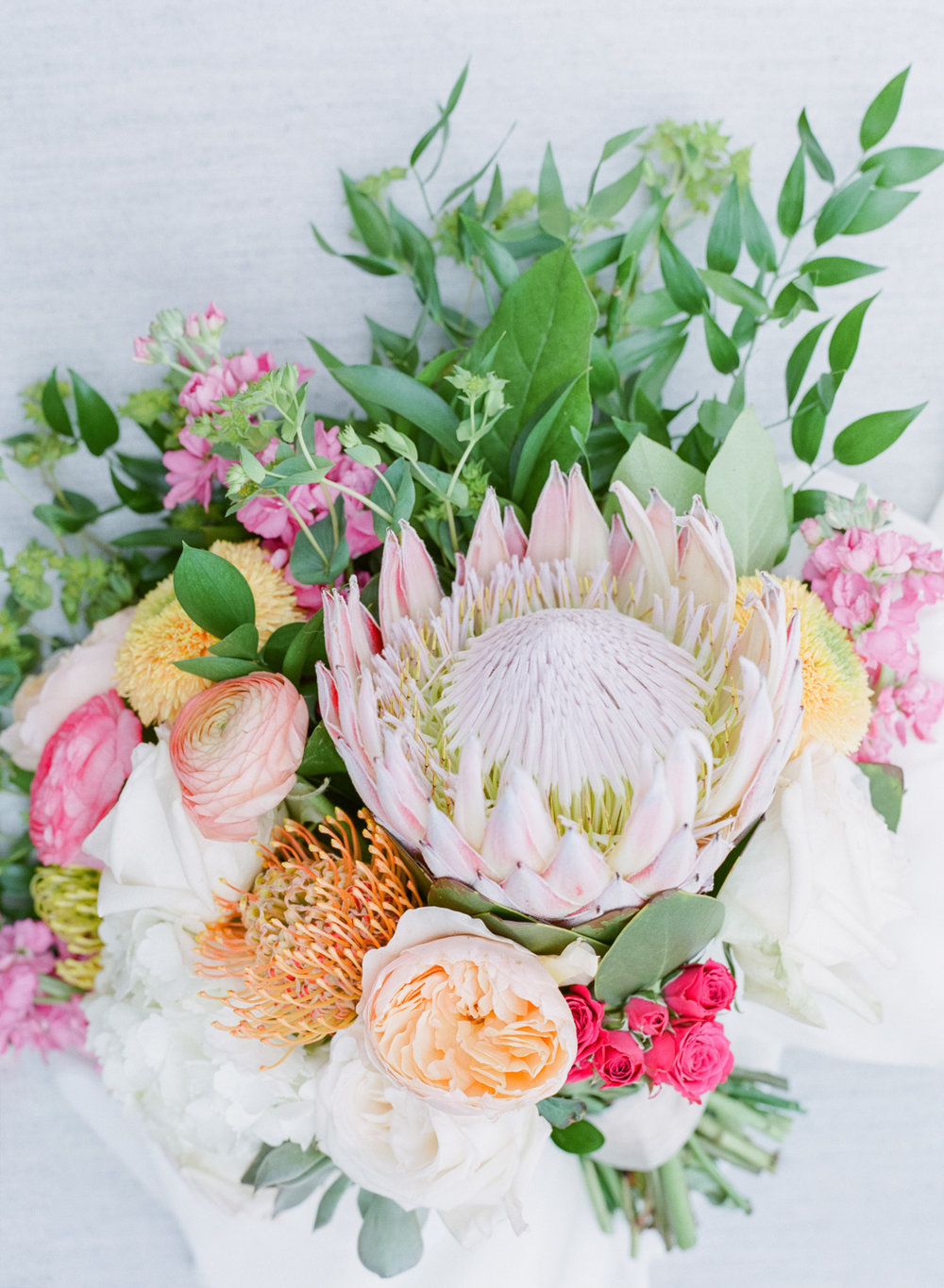 Large, colorful bouquet containing protea