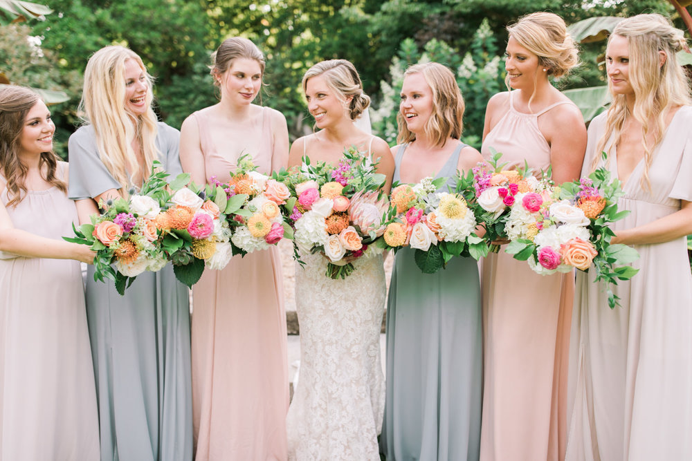 Summer Yew Dell wedding photo of bridesmaids holding bouquets