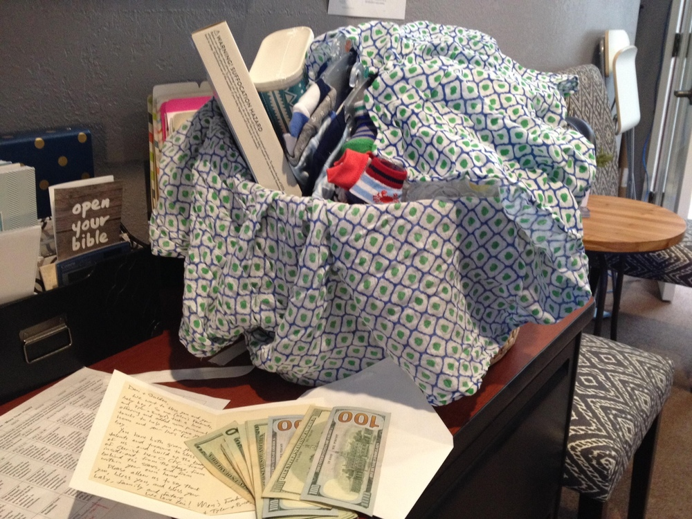 The thoughtful and generous monetary gift from Tyler's men's group and a basket full of goodies from Bridget!