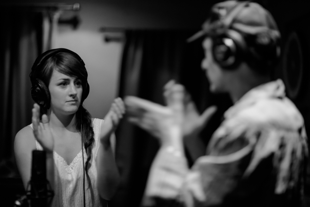 Putting on our serious face for recording hand-claps. (We cracked ourselves up so many times.)