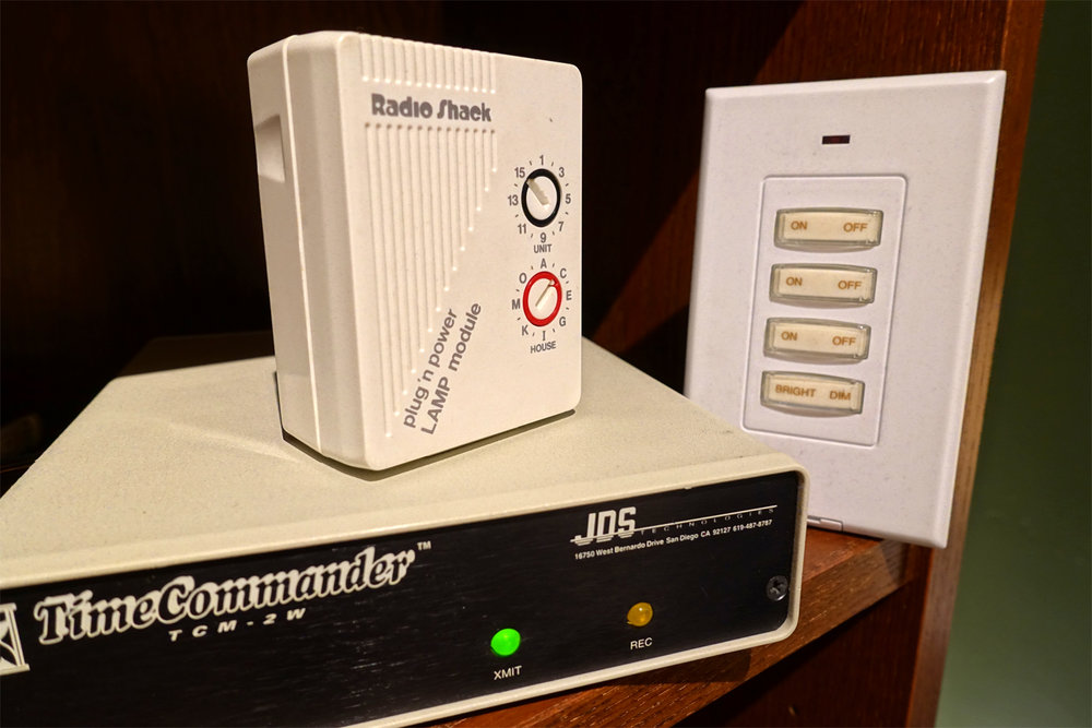 An X10 plug-in module, wireless controller and the JDS TimeCommander central X10 controller