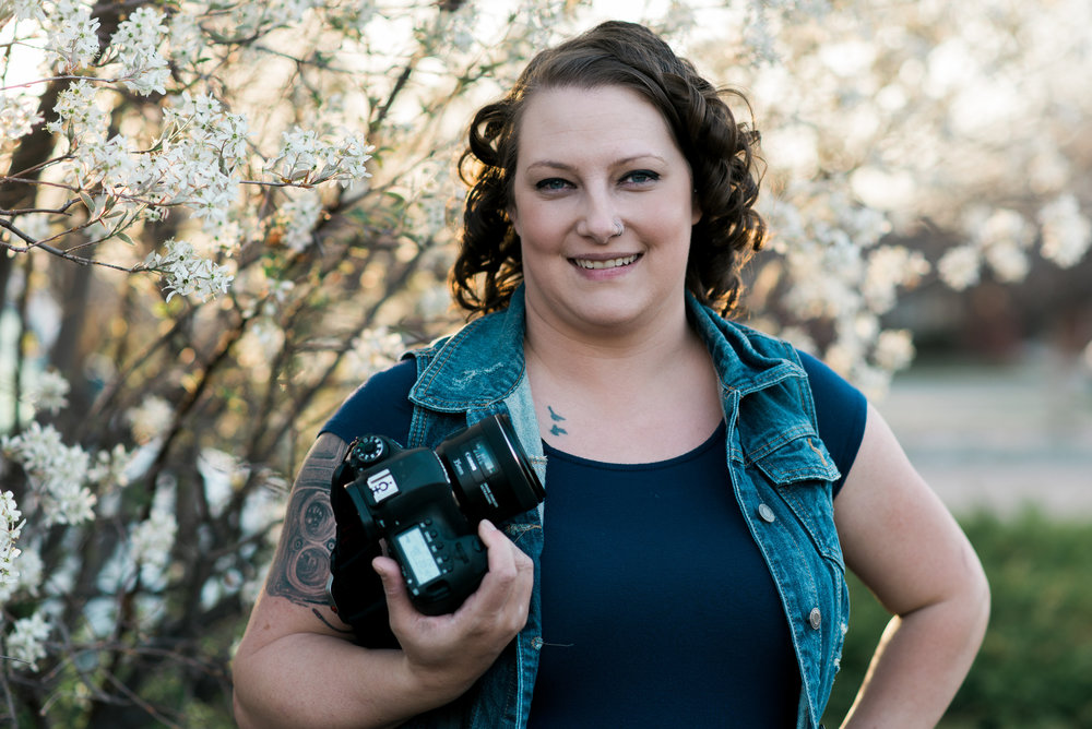 Nicole has a sweet camera tattoo on her right arm!   Nicole Pettit Photography.