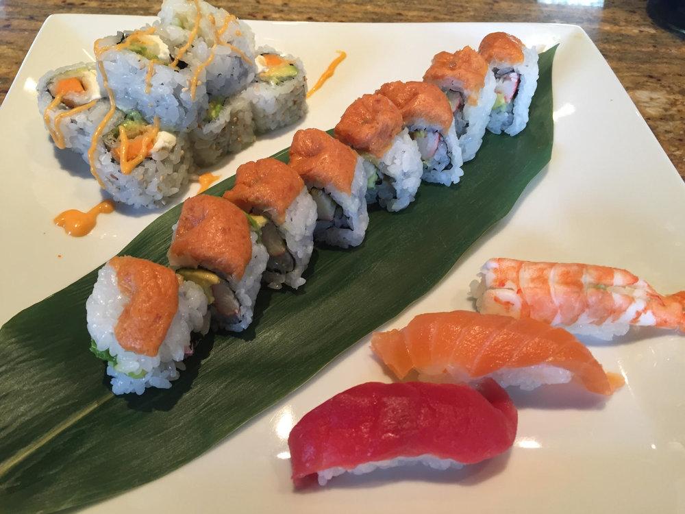 @ sweet potato tempra, avocado & cream cheese @ california roll, spicy tuna ontop @salmon, tuna & shrimp nigiri