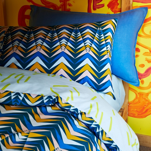 Pointed Arrow   -from $99.95 - The kids Pointed Arrows design features a unique print of quirky arrow shapes atop a gorgeous navy base. Created from 250 thread count ultrafine cotton percale this super soft quilt cover set offers a contrasting reverse of scattered matchstick shapes across a sky blue base, a wonderful alternate styling option.
