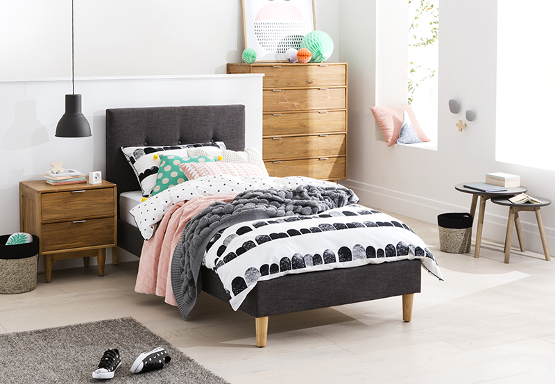 With a playful sense of maturity, solid pine feet and a fully upholstered classic design finished with a button detail makes the Jasper a stand-out option for any kids' bedroom space.  Jasper Single Bed: From RRP $499 - pictured with the Cino Bedside Table and Tallboy