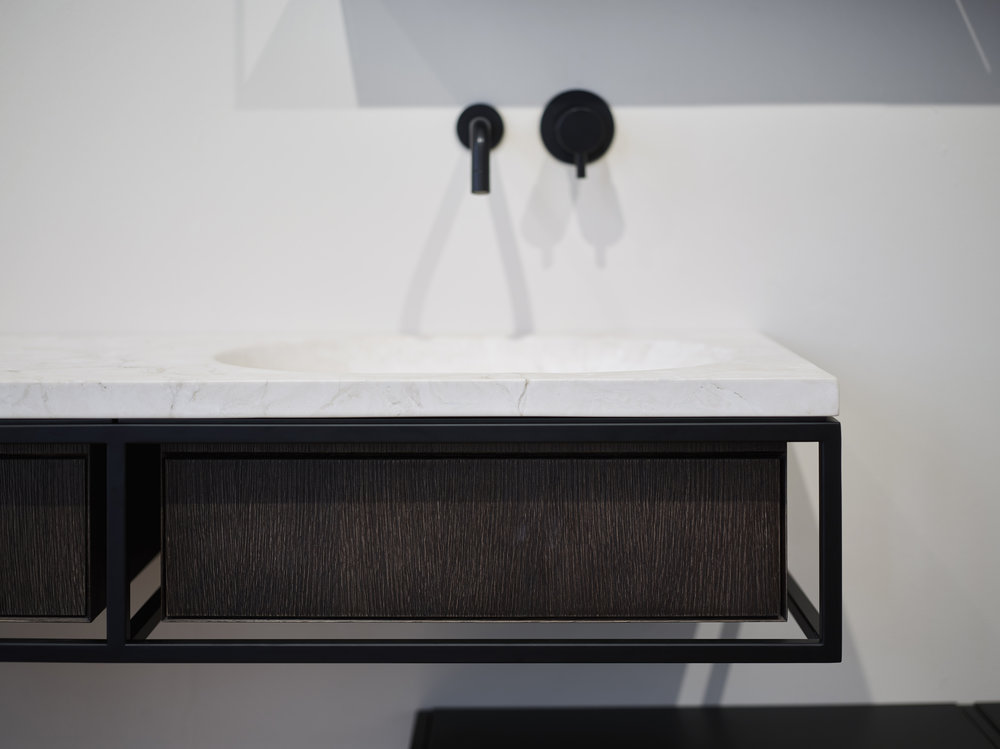 Frame System Special Addition -The Frame System launched last year was announced winner of the Elle Déco International Design Award in the Bathroom category during Milan Design Week and presented an exclusive edition of the popular collection. Smoked oak and Navona travertine are the features chosen by Norm Architects to bring warmness & a hearty feeling to the collection. Inspired by bathroom consoles from industrial interiors and mid 20th century Danish design furniture, Frame is a light, airy set of bathroom furniture which can evolve along with your home whilst decorating many different living spaces. Featuring a modular system of consoles and furniture embodying a Nordic attitude with the Italian core of traditional craftsmanship, conceived for a new market which is more and more asking for versatile bathroom furniture.