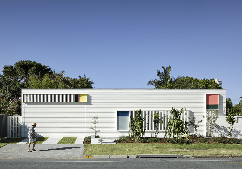 Single Residential Exterior Winner Project: Burleigh Street House by ME -  Featured Dulux colours: Melon Baby, Ginger Crunch, Stella, Black Water, Duck Egg Blue, Night Life, Indian Summer, Mondrian Blue and White Watsonia  Photo by Christopher Frederick Jones.