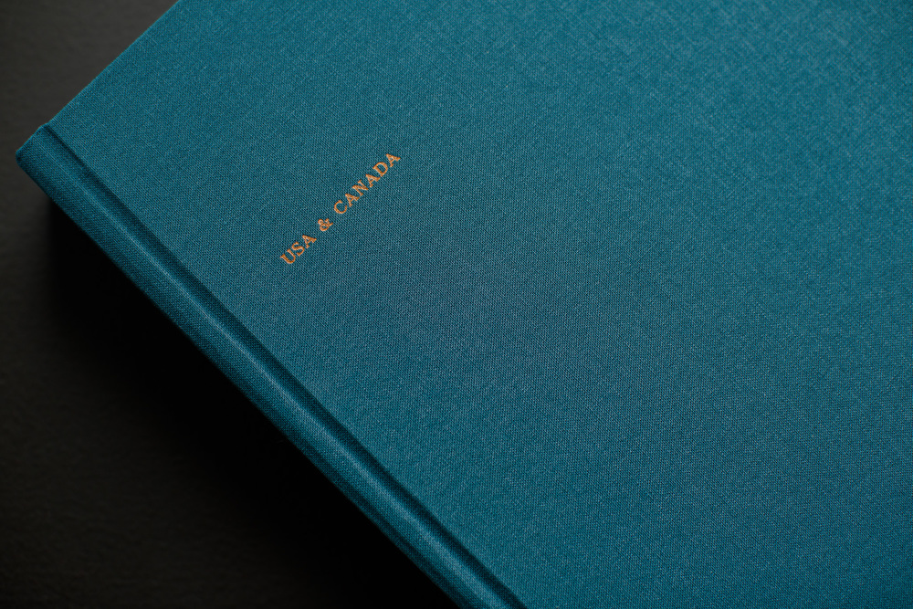 Pacific Blue fabric cover and copper embossed foiling