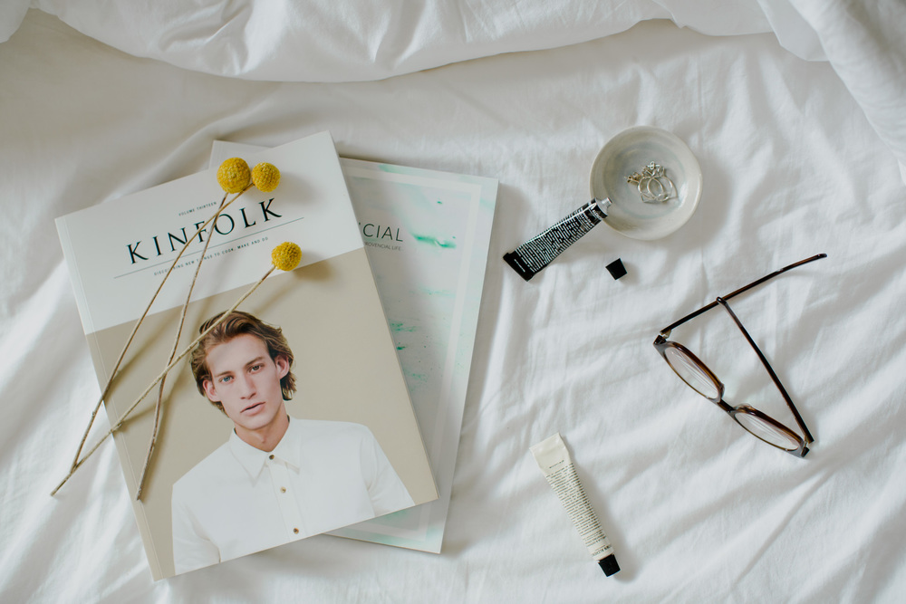 Bedside table essentials flatlay. Create and style a bedside table vignette.