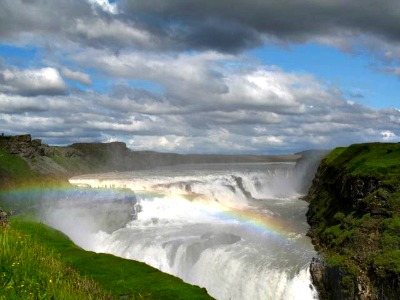 The sun and spray guarantees a rainbow at Gulfoss waterfall.