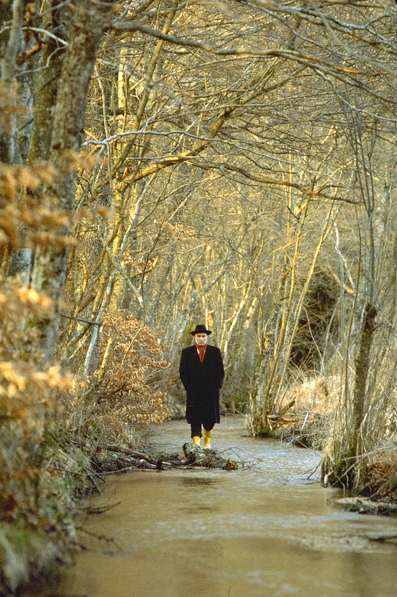 President Mitterand walking in the forest near Chateau Chinon.