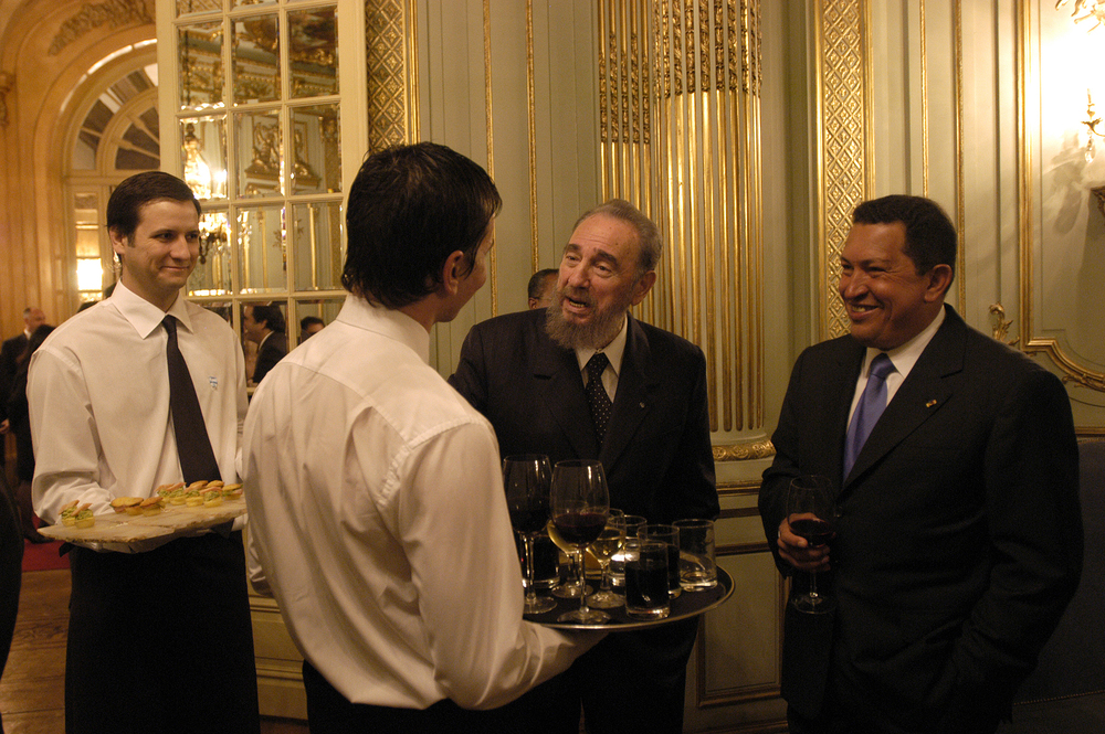 Fidel Castro and Hugo Chavez at a cocktail in Buenos Aires, 2003.