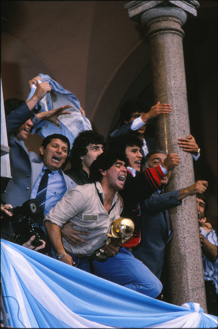 Maradona with the 1986 soccer world cup in the Presidential Palace balcony, Buenos Aires.