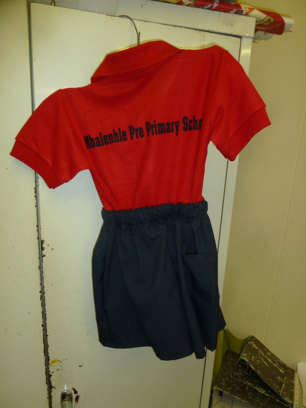 A school uniform made by a sewing group in Phakamisa