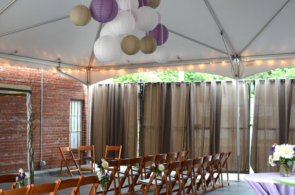 Open-air tent with paper lantern chandelier from Tre Bella