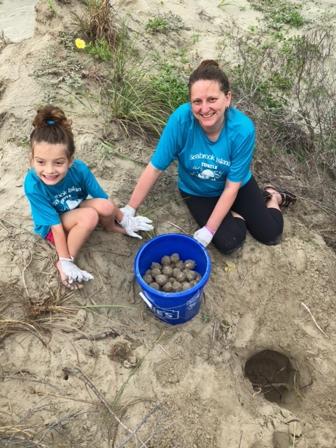 Rachael and Neva Carter helping relocate the nest